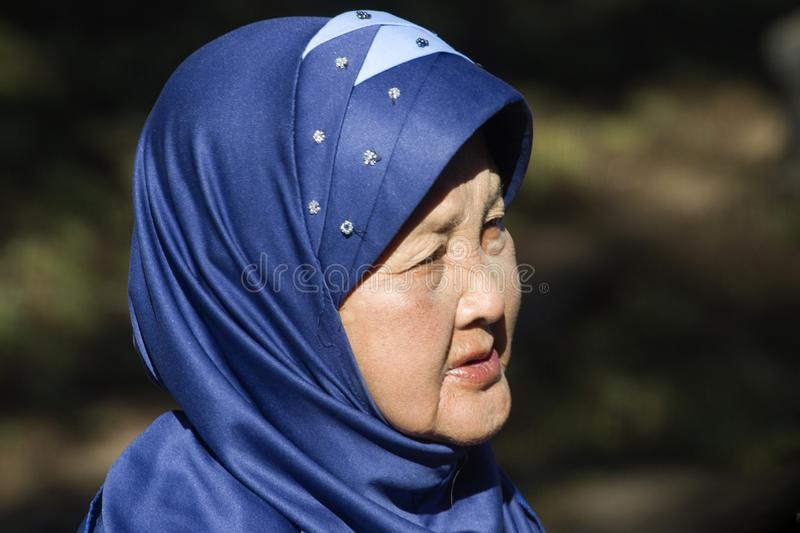 Indonesian woman with a blue headscarf stock image
