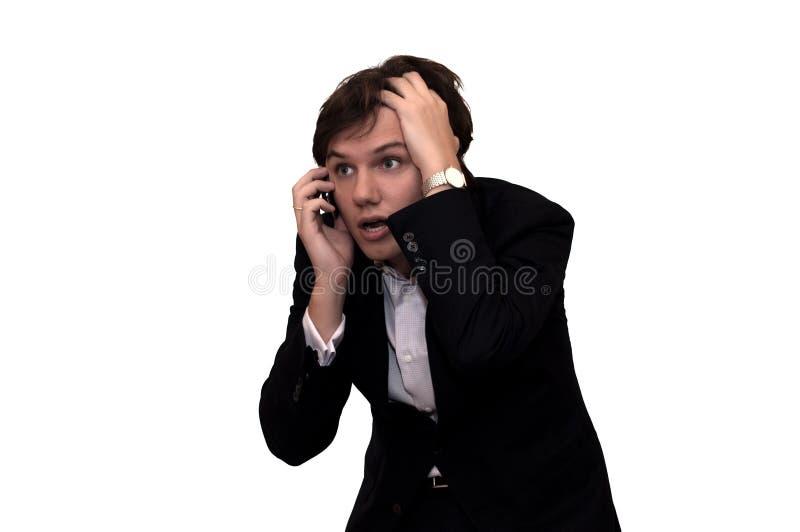 Malas noticias en el teléfono. Aislado en blanco fotos de archivo