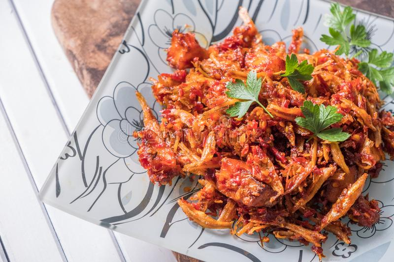 Malay dish stir fried chili with deep fried anchovies and potato cubes. Or locally known as ikan bilis goreng berlada royalty free stock photo