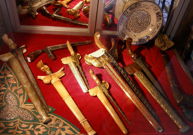 Malay keris or kris. A display of many Malay ethnic daggers, beautifully ornate and decorated. Ethnic name is the keris or kris. Some comes with straight and stock image