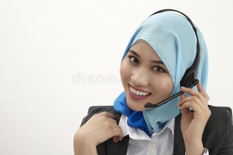 Malay receptionist,. Malay receptionist with tudung on the white background royalty free stock photos