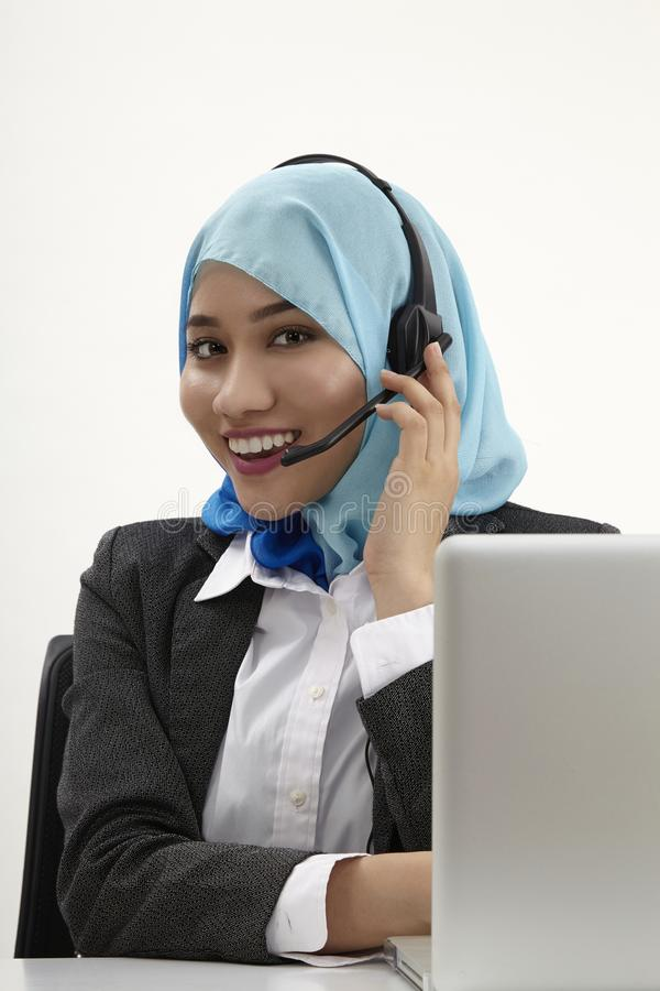 Malay receptionist,. Malay receptionist with tudung on the white background stock photos