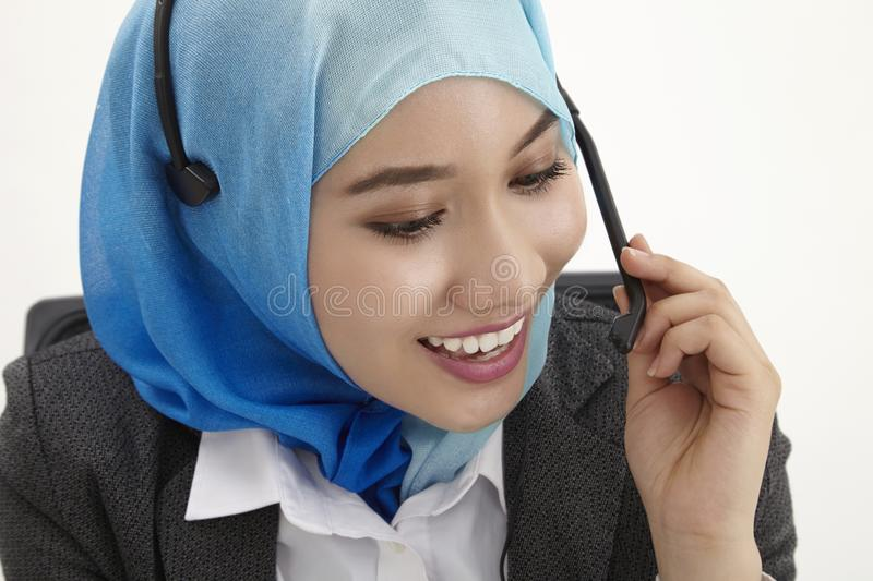 Malay receptionist,. Malay receptionist with tudung on the white background stock images