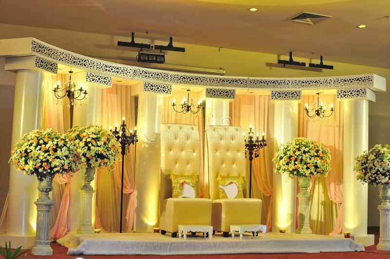 Malay wedding chair and stage decoration. Grand stage of a Malay wedding ceremony stock photos