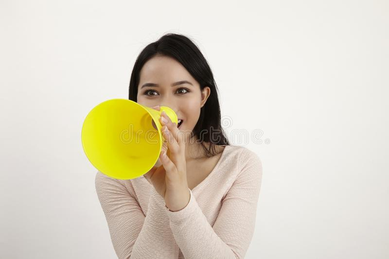 Speak out. Malay woman using megaphone on the white background stock photos