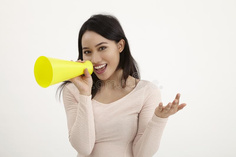 Speak out. Malay woman using megaphone on the white background royalty free stock images