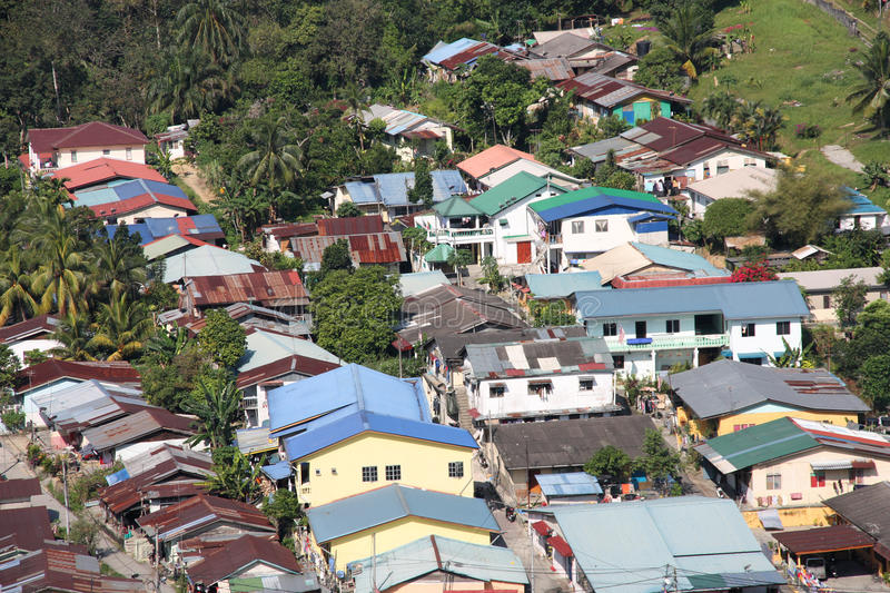 Malaysia. Aerial view of a poor neighborhood in Kuala Lumpur, Malaysia. Housing district on the edge of rainforest jungle stock photo