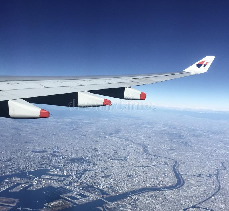 Malaysia Airline b777. Seen here Malaysian Airline Boeing 777 flying over Tokyo Bay. The airline is undergoing a financial crisis with the new government royalty free stock images