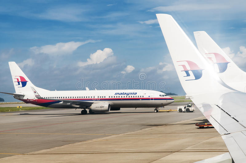 Malaysia Airlines Airplane. KOTA KINABALU, MALAYSIA - DECEMBER 24, 2014: A Malaysia Airlines flight is being pushback by a tow tug at Kota Kinabalu International stock photography