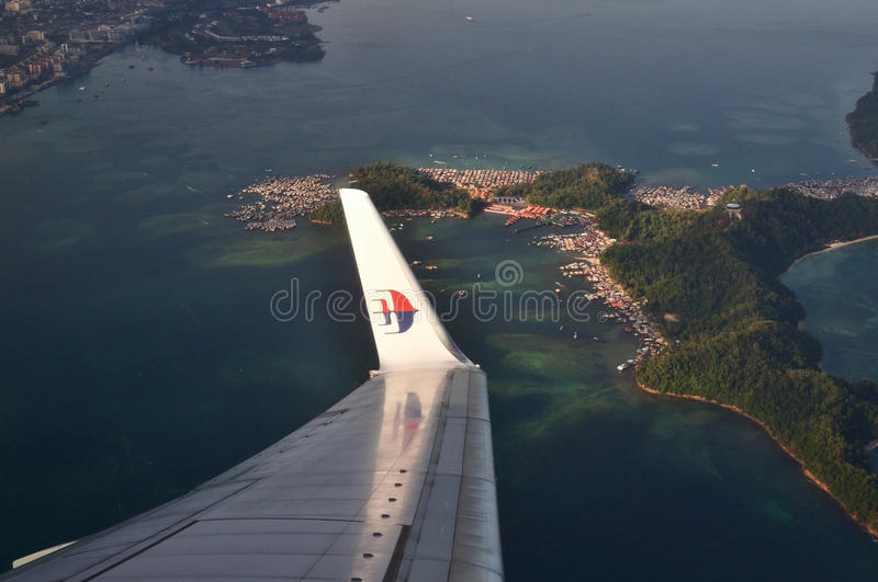 Malaysia Airlines Boeing 737-800 flying over Kota Kinabalu, Sabah Borneo. KOTA KINABALU, MALAYSIA - APRIL 17 : Malaysia Airlines Boeing 737-800 flying over Kota royalty free stock photography