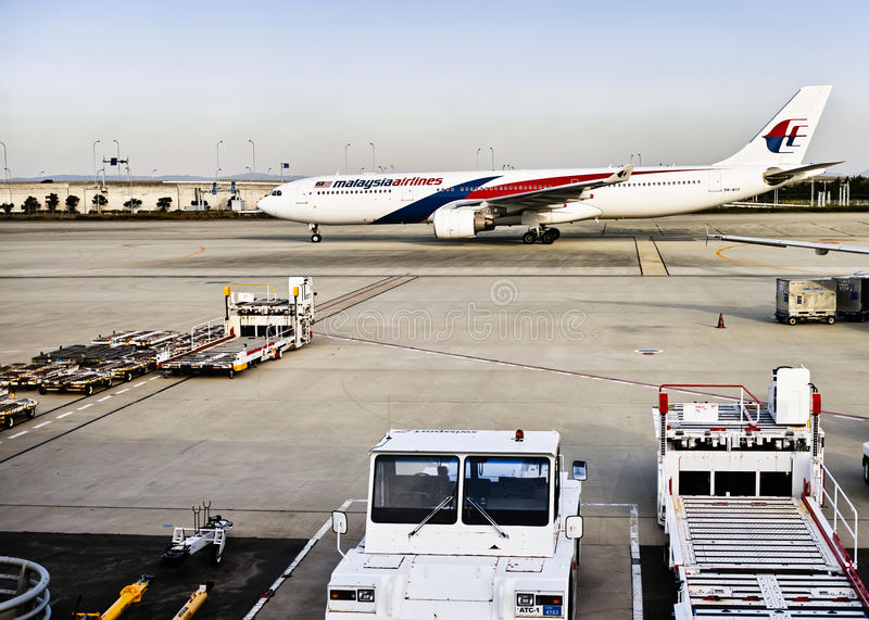 Malaysia Airlines plane landed. In Japan Osaka Airport stock photos