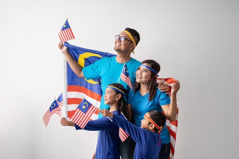 Malaysia family with attributes and flag celebrating royalty free stock images