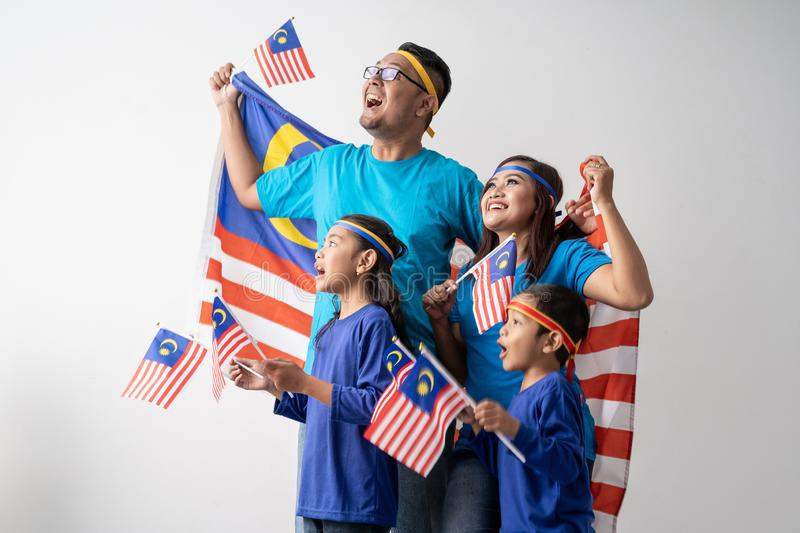 Malaysia family with attributes and flag celebrating royalty free stock photography