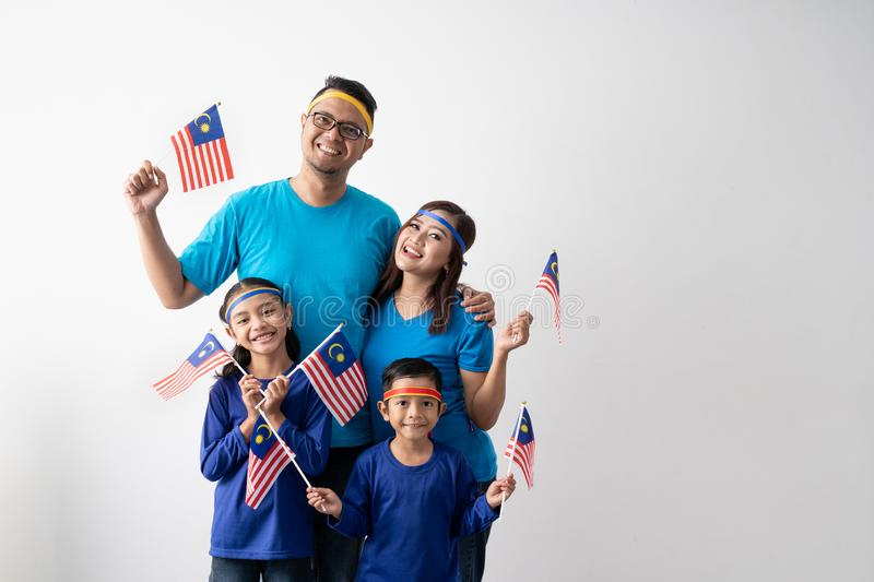 Malaysia family with attributes and flag celebrating royalty free stock photos