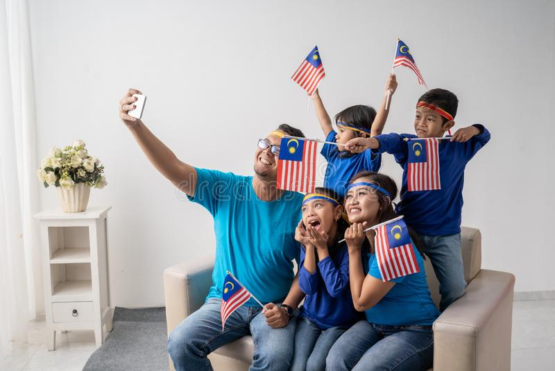 Malaysia family with kids take selfie stock photos