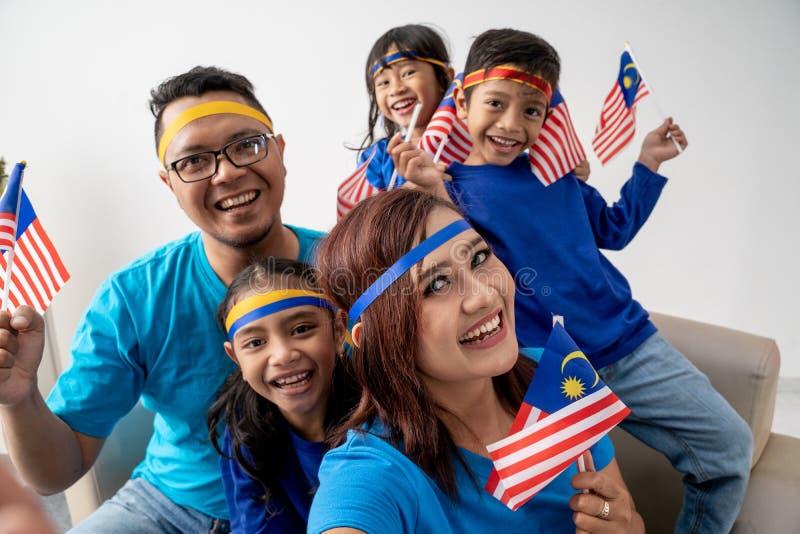 Malaysia family with kids take selfie royalty free stock photo