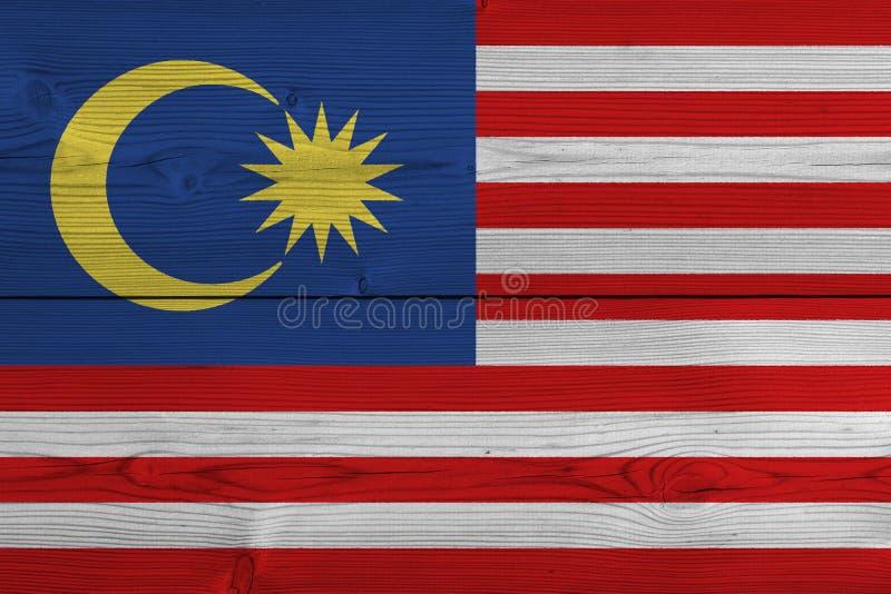 Malaysia flagga som målas på gammal träplanka stock illustrationer