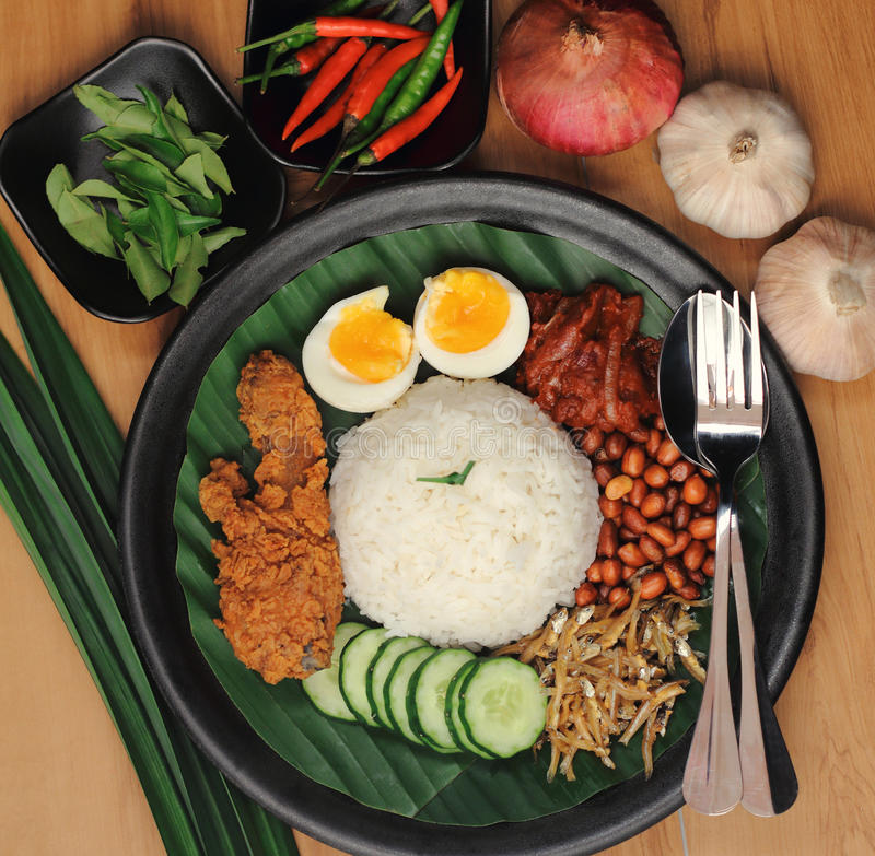 Malaysia food nasi lemak. Nasi Lemak is a commonly found food in Malaysia, Brunei and Singapore. It is also an unofficial national food in Malaysia stock image