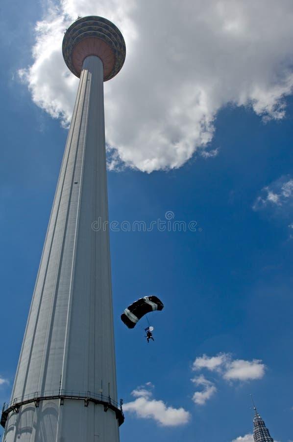 Malaysia Kuala Lumpur International Tower Jump. Malaysia Kuala Lumpur International exhibition of Tower Jump; blue sky and colorful parachute; Kuala Lumpur tower royalty free stock image