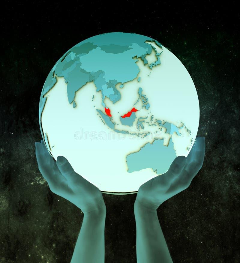 Malaysia på det blåa jordklotet i händer royaltyfri illustrationer