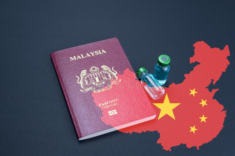 Malaysia passport and anti vaccine vials. Medical health concept. stock images