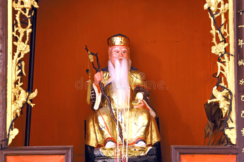 Malaysia, Penang: Chinese temple. Malaysia, Penang: chinese family temple; a detail of the inside decoration; niche with religious statue royalty free stock image