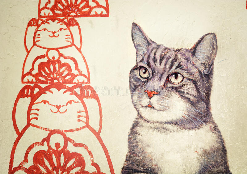 MALAYSIA, PENANG, GEORGETOWN - CIRCA JUL 2014: Mural with realistic picture of a tortoiseshell cat beside red, stylized rendering stock illustration