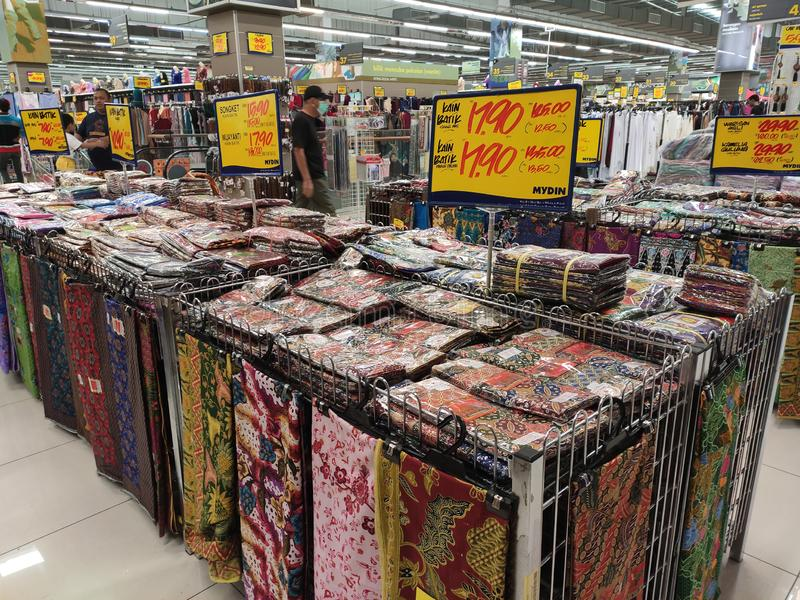 Malaysian batik cloth for woman displayed for sale inside the supermarket. KUALA LUMPUR, MALAYSIA -JUNE 02, 2019: Malaysian batik cloth for woman displayed for royalty free stock photography