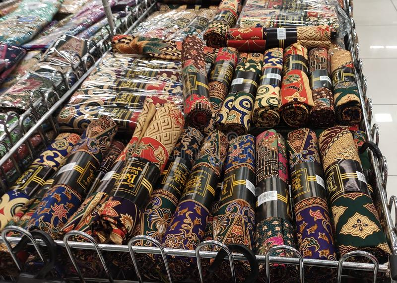 Malaysian batik cloth for woman displayed for sale inside the supermarket. KUALA LUMPUR, MALAYSIA -JUNE 02, 2019: Malaysian batik cloth for woman displayed for stock images