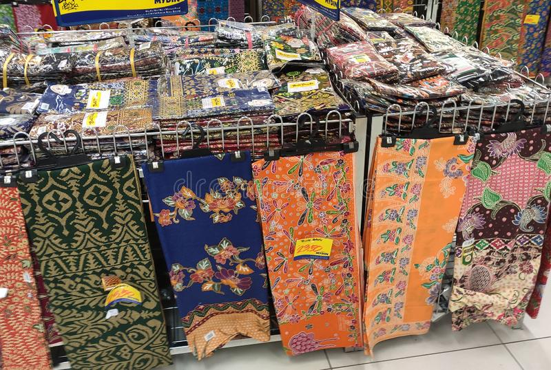 Malaysian batik cloth for woman displayed for sale inside the supermarket. KUALA LUMPUR, MALAYSIA -JUNE 02, 2019: Malaysian batik cloth for woman displayed for stock image