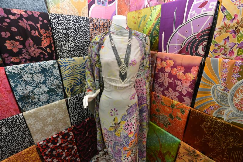 Malaysian Batik. Making is different from those of Indonesian Javanese batik, the pattern being larger and simpler with only occasional use of the canting to royalty free stock photos