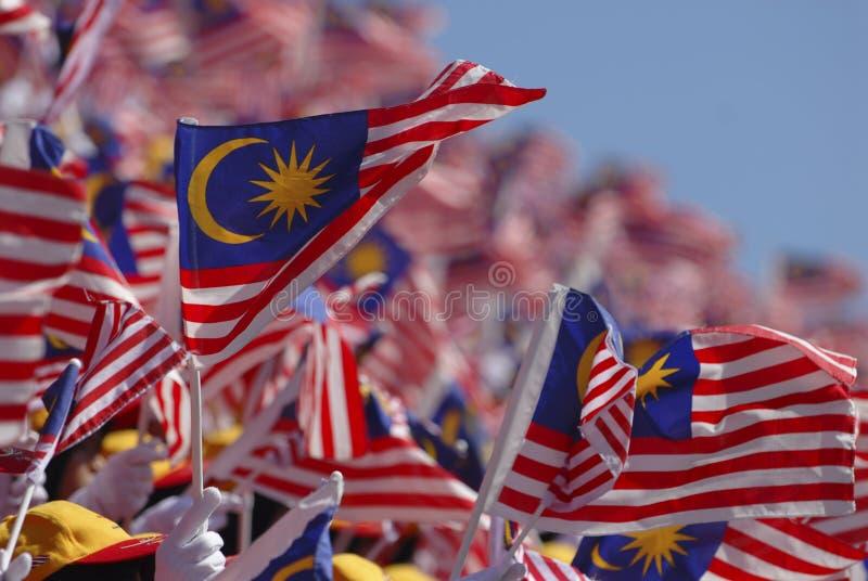 Malaysian flag. Crowd waving Malaysian flag during Malaysia 50 years of independence
