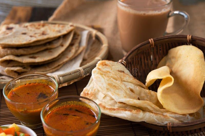Malaysian food. Roti canai, Chapati or Flat bread, teh tarik or milk tea and curry, famous Malaysian Indian food stock images
