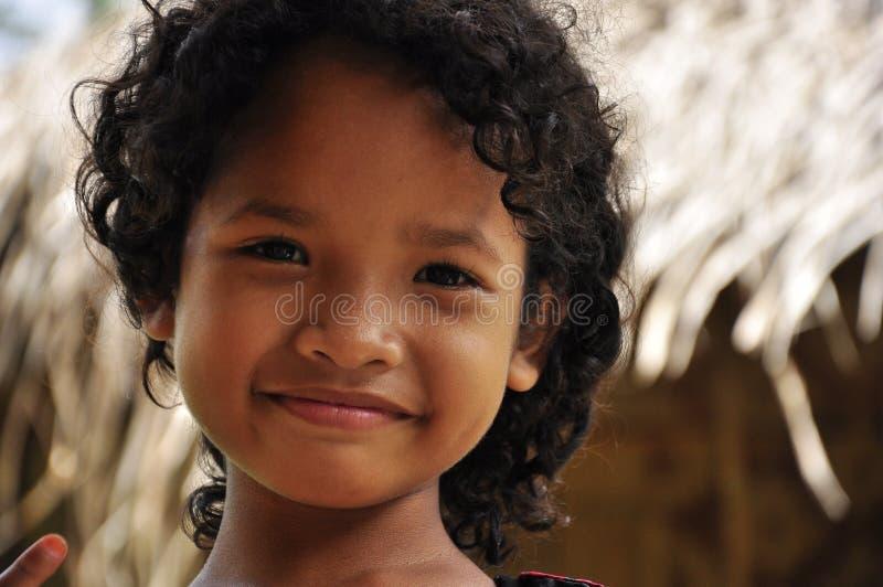 Malaysian indigenous girl smiling serene stock photo