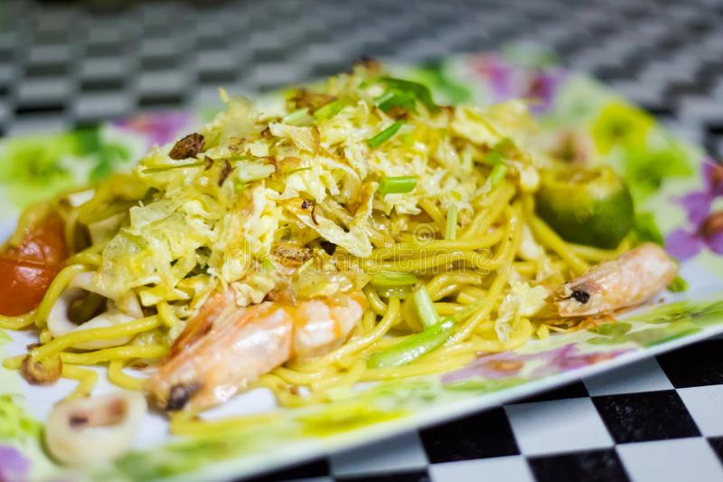 Malaysian Mee Goreng Singapore noodle. Fresh prepared malaysian Mee Goreng Singapore mixed seafood noodle served in local restaurant on Tioman island stock images