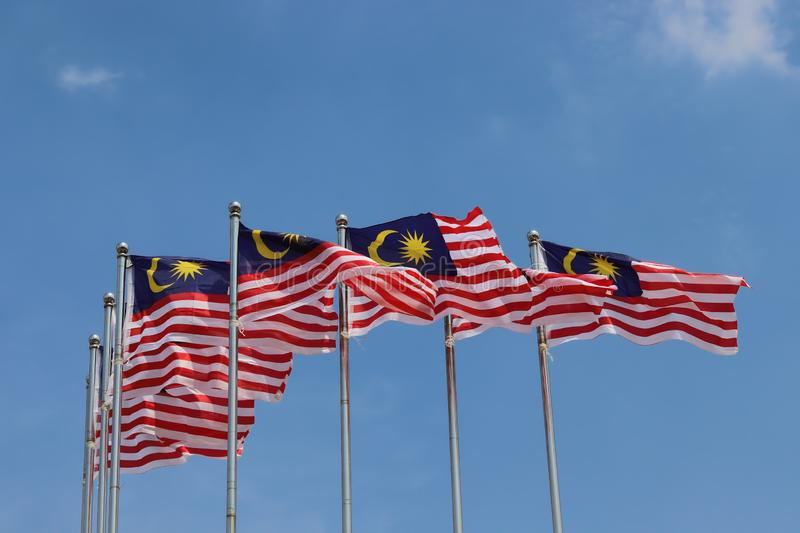 Malaysian National Flag Display. A display of the Malaysian national flag under a blue sky with some patches of cloud royalty free stock photo