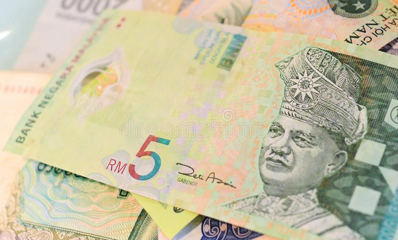 Malaysian Ringgit banknote on another Southeast-asian currency stock image