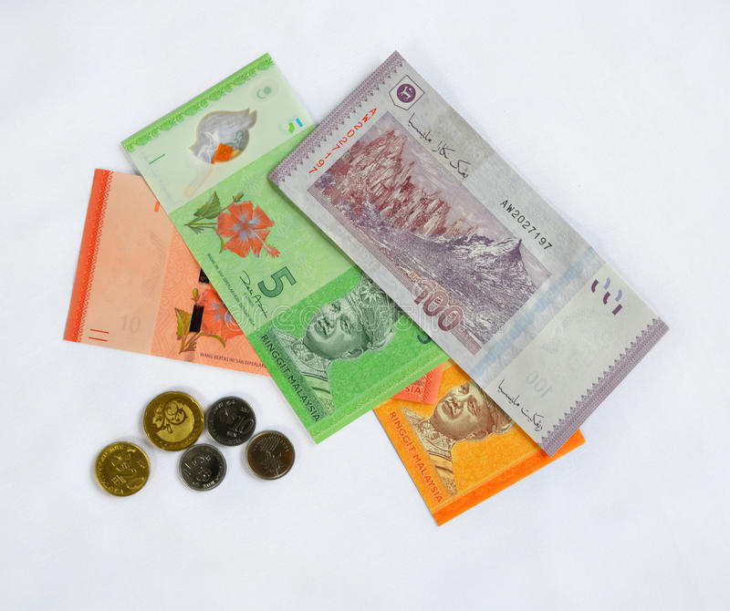 Malaysian Ringgits and Cents. Malaysian ringgit notes and coins isolated on white background royalty free stock image