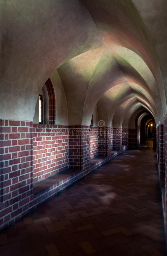 Malbork castle corridor. Narrow corridor of the Teutonic castle Malbork in Pomerania region of Poland. UNESCO World Heritage Site. Knights fortress also known as royalty free stock photos