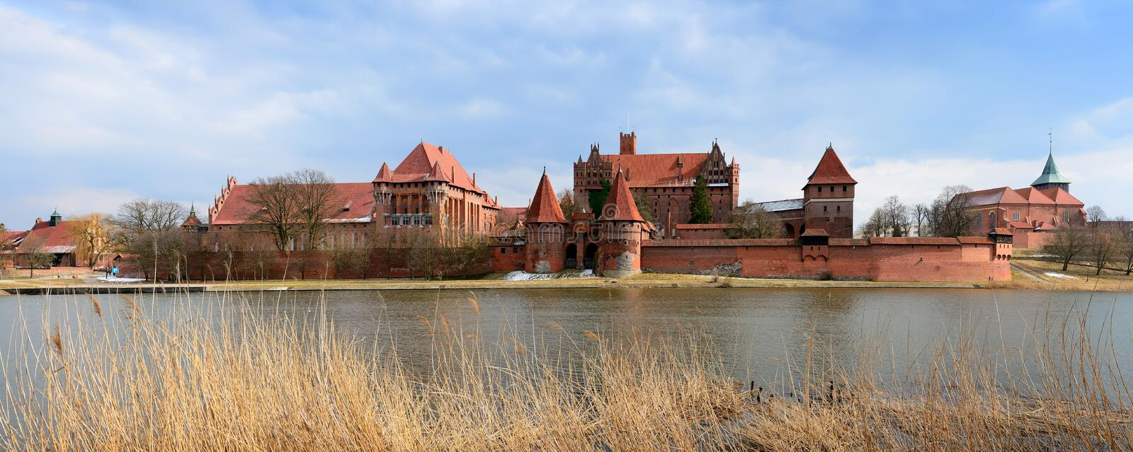 Malbork castle in poland. Panorama with medieval castle in malbork (marienburg), poland royalty free stock photos