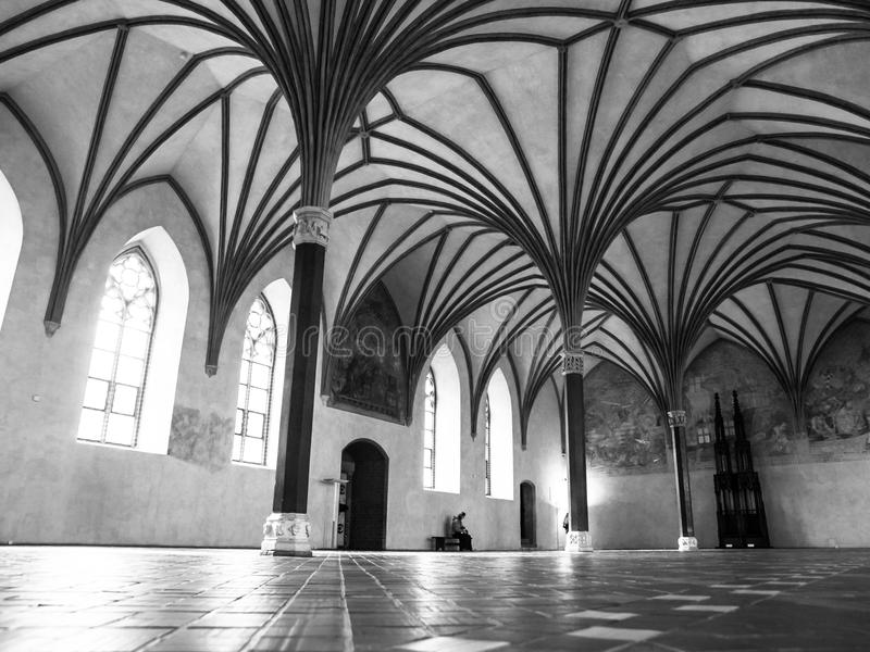 Malbork Grand Refectory. The Grand Refectory, the biggest hall in Malbork Castle with beautiful gothic rib vault ceiling, Poland. Black and white image stock photo
