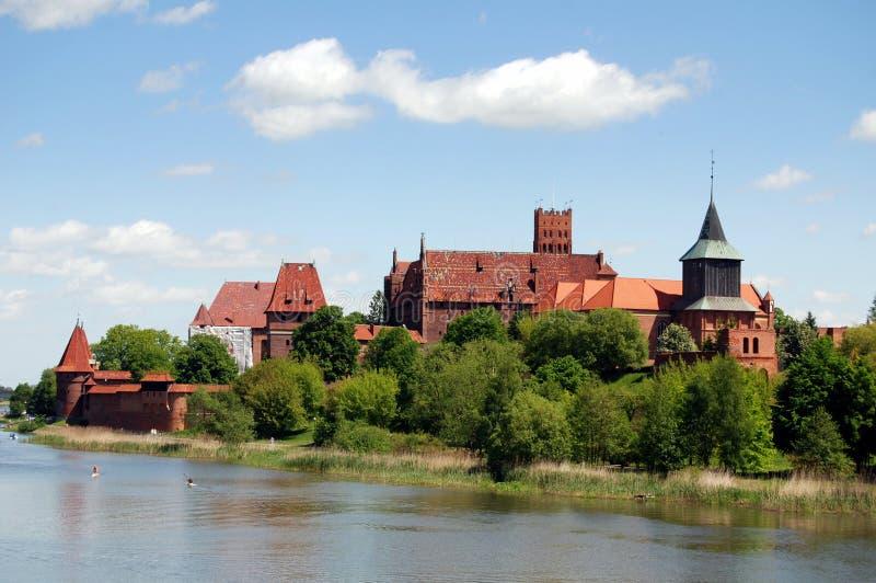 Malbork, Polen: Het Kasteel van Malbork stock foto's