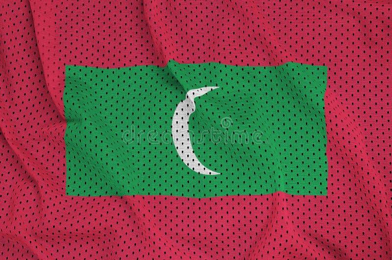 Maldiverna flagga som skrivs ut på en fabri för ingrepp för polyesternylonsportswear arkivbilder