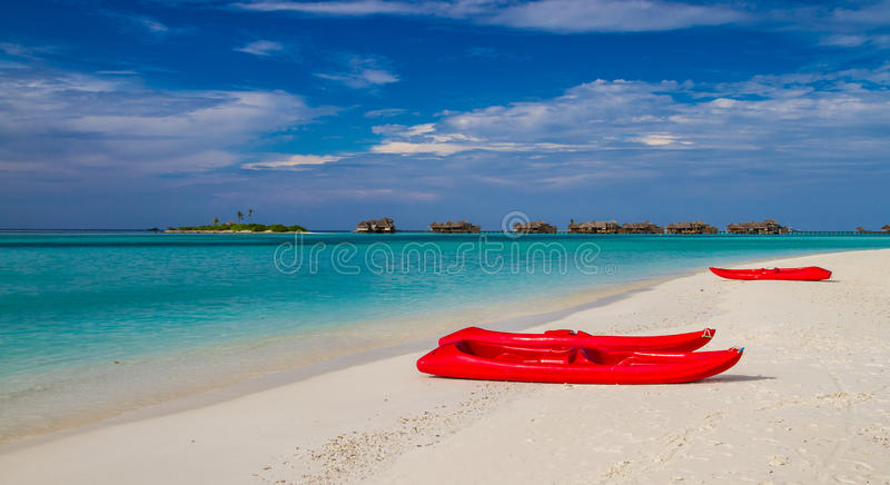 Maldives beach panorama under the blue sky. Maldives beach panorama. Luxury water villas, in exotic blue lagoon. Wide screen background concept. Magical royalty free stock image