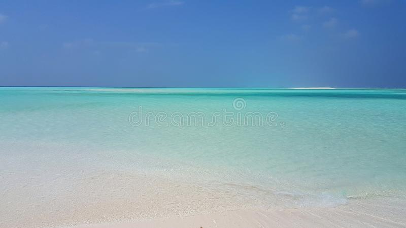 P01388 Maldives beautiful white sandy beach background on sunny tropical paradise island with aqua blue sky sea water. Maldives beautiful white sandy beach royalty free stock images