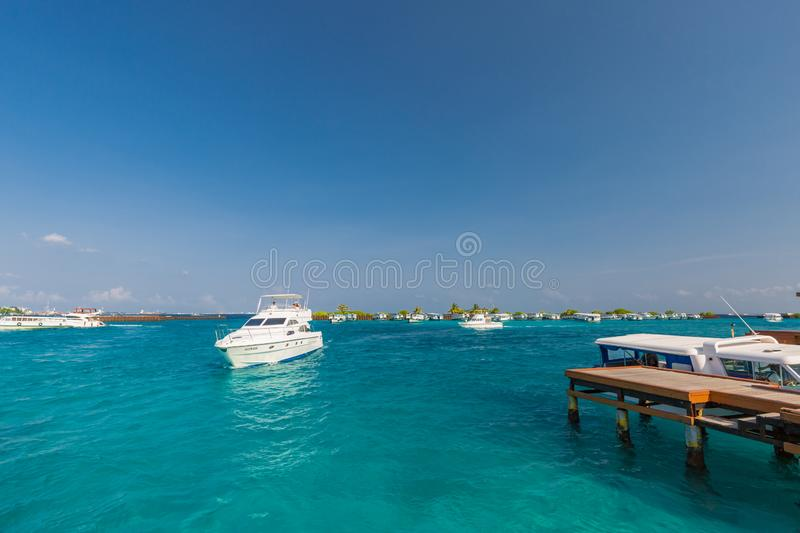 05.03.18 - Male Maldives airport dock and boats picking up tourists next to Male capitol city of Maldives. Luxury speedboat coming royalty free stock photo