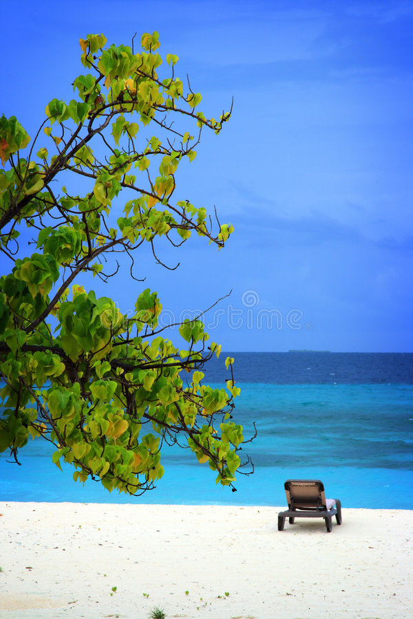 Maldives: Holiday feeling. Beautiful view from a villa in a small resort island in Maldives. Indian ocean and white sandy beach with tropical winds really makes royalty free stock photography