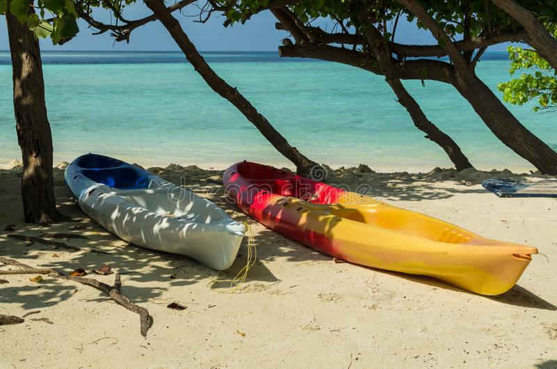 Two colorful boats on the white sand of the tropical island, Maldives, holidays destination stock image