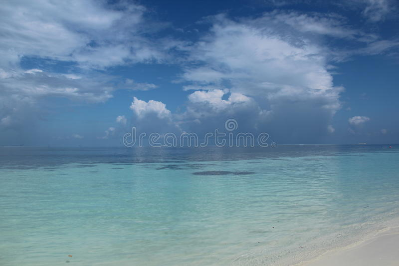 Maldives. Paradise island tender clouds white sand, beautiful island gentle sky stock photography