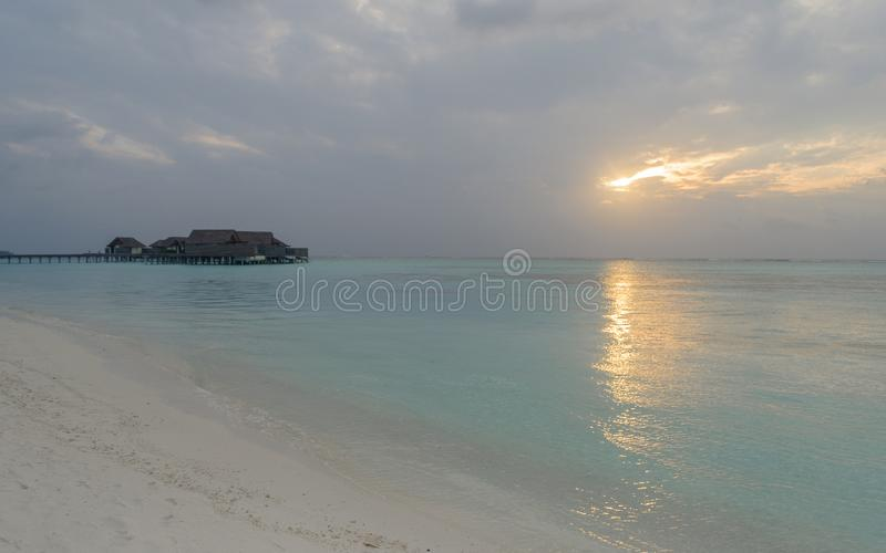 Sunset : overwater bungalows at Maldives Islands stock image